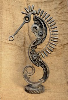 Sculpture from scrap by Volodymyr Vasyliuk (Ukraine). (Car Parts).=2