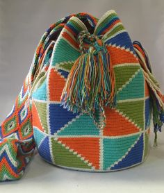 Another of one of our hand-picked Mochilas is now online. The joy that we receive from working with the tribeswomen is indescribable. Making a difference in their lives makes us feel good about what we do everyday❤️ help us support them with the purchase of your mochila. ✨ #mochila #Wayuu #wayuutribe #bohochic #fairtrade #artisangoods #handmade #bohemian #boho #hippiechic #yogalufe #givingback #igstyle #resortstyle #handcrafted