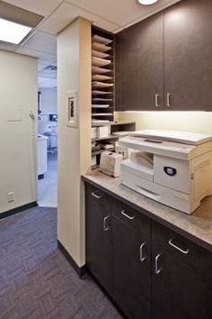 Paul E. Berg, DDS Dental Clinic. Forms, paper and technology are integrated to reduce clutter.