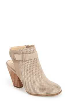 These perforated suede booties will look great with distressed jeans.