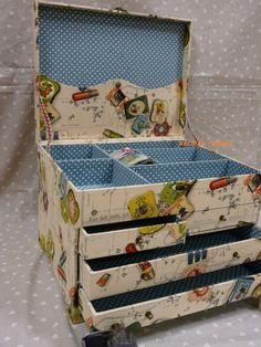 upside down shoe box tops, boxes from best buys, craft store fabric glue & fabric or wall paper, cut cardboard stripes covered, jeweled drawer pulls for legs & drawers...presto....