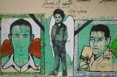 Mohamed Mostafa is surrounded by nameless martyrs, all of whom died on February 1st