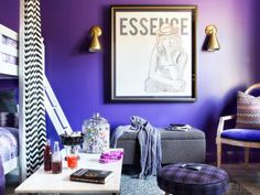 To make what was a juvenile, childish girl's room more appropriate for a growing tween, its walls were painted a deep shade of violet, album cover-inspired art was hung to create a focal point, vintage lighting was installed on the ceilings and the walls, and women's fashion fabrics were used in upholstered accents.