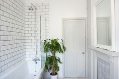 Victorian shower with metro tiles