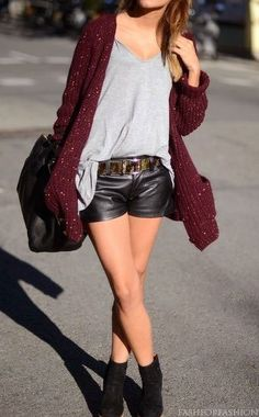 in chilly weather, leather shorts look awesome with a long, cozy cardigan and ankle boots