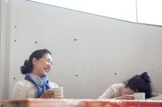 Two momen drinking coffee at a table stock photo