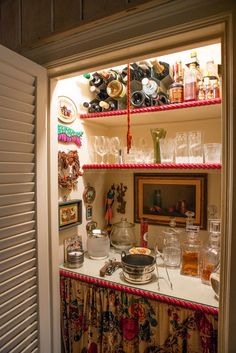 Closet made into a bar with fridge below the curtain at Betty Halbreich's Park Avenue apartment.