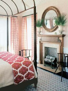 British Colonial style bedroom. Love that large round mirror over the mantle. #kathykuohome