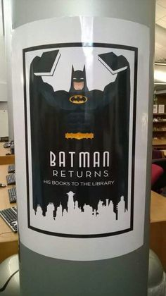 Batman  returns...his books to the library