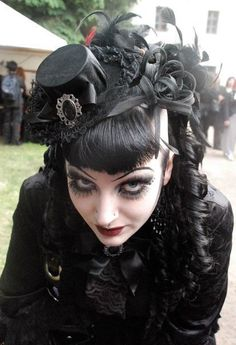 Mini-top hat!  The curls are a nice touch and the makeup is lovely.
