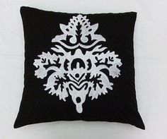 Black throw pillow and cushion cover with white damask