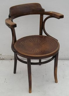 A bentwood open armchair with Thonet Poland pressed seat and bentwood beech arms. Michael Thonet