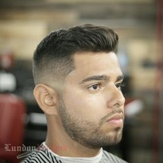 Low skin fade with with a pompadour Dora and Scruffy beard