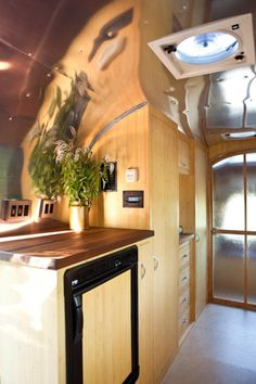 Incredible renovation of a vintage Airstream trailer - even *I* would camp in this! (lots more photos)
