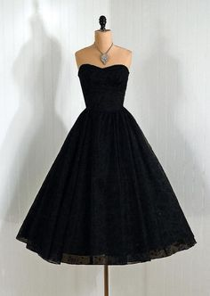 Timeless 1950's dress If it wouldn't get totally trashed I would totally wear this to work...obviously with my boots!