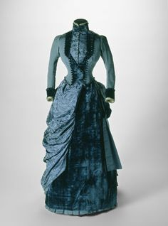 Blue silk and velvet dress (front view), 1884-85. Worn at a wedding in 1885.