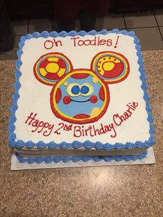 Square blue, red, and yellow Toodles birthday cake