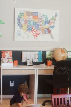 Kid-friendly writing center. Love the map.