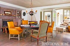 A kid-oriented remodel led to the creation of this casual dining area -- a large room that serves as an all-around hub for the family. Bleached pine on the floors and ceilings as well as on cabinets surrounding the fireplace directs the room's calm palette. Combined with sparse furnishings, the result is a perfectly serence space. The Belgian bluestone table is from Watkins Culver Antiques. Dining chairs are covered in contrasting upholstery from Edelman Leather.