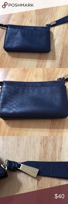 NEW OLIVIA & JUNE Navy Expandable Wristlet NEW OLIVIA & JUNE Navy Expandable Wristlet, never used,  pictures provided of condition,✨WILL SHIP IN ONE DAY✨All bundles of 2 or more receive 20% off.🧡 Olivia + Joy Bags Clutches & Wristlets