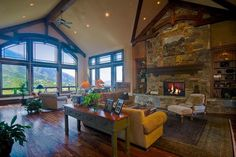 Expansive rock fireplace with beam highlights