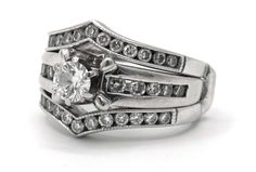 Sparkling engagement ring, crafted in gold, featuring a round center diamond, channel style band with round diamonds, comes with ring guard with round diamonds Diamond Rings, Diamond Engagement Rings, Ring Guard, Round Diamonds, Class Ring, Rings For Men, White Gold, Sparkle, Wedding Rings