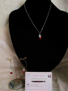 Tear drop crystal pendant and earring hoops.