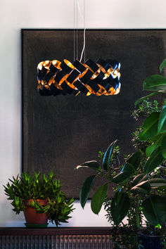 The Ring Ceiling Pendant designed by Brain Rasmussen takes centre stage with it's striking use of shape and unique design. It's available in 3 sizes of a rather large scale and many different colours. Due to this it is perfect for a statement light either over a dining room table or even a kitchen island.