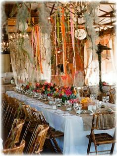 fabric scrap garland with feathers and twine. I don't know what I would do with it, but I want one.