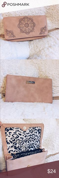 Jessica Simpson wallet Light baby pink Jessica Simpson wallet! Never used and brand new! Has a lot of slots on each sides of and a pocket in the middle for change! Jessica Simpson Bags Wallets