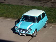 Blue Classic Mini, view from the window http://www.jagspares.co.uk/Mini/company.asp