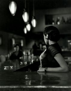 black and White Photo of Girl at a Bar