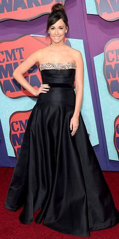 Thank goodness Female Video of the Year nominee Kacey Musgraves didn't follow our hair suggestions! Instead she opted for a sleek updo to complement her chic black strapless dress with an embellished neckline.   http://www.people.com/people/gallery/0,,20823101,00.html#30167387