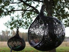 Hanging chair formed using volcanic rocks.  Luxeyard.com   Ed would never get up again!  And I'd be in the other one!