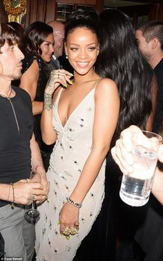 Glamming it up: Rihanna dazzled in her jewel-encrusted dress, which she glammed up with numerous rings, earrings, and a bracelet