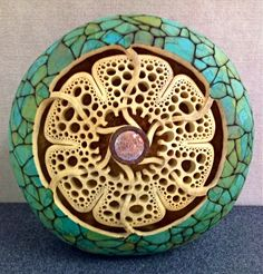 """Celtic Flower"" 14"" in diameter.  Carving by Mark Doolittle; paper applique by Kathy Doolittle."