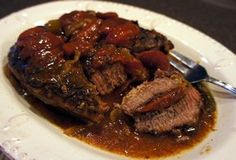The goold family loves this!!!!    Slow Cooker Beef Roast with Tomatoes and Gravy Recipe from RecipeTips.com!