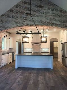 Interesting brick spices up this kitchen area.