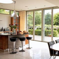 Let the light flow into your open plan kitchen with glass bi-folding doors. Love the floor to ceiling height. http://www.housetohome.co.uk/room-idea/picture/kitchen-extensions-25-of-the-best/6