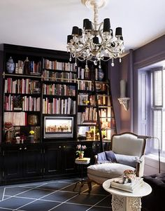 small but grand library bookcase himself and painted it highgloss black by fine paints of europe the floor painted to mimic a rug