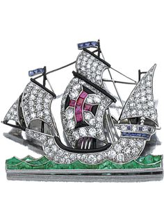 GEM-SET AND DIAMOND BROOCH, 1930S  Designed as a clipper ship, decorated with single- and circular-cut diamonds, buff-topped calibré-cut emeralds, sapphires and rubies, and onyx, mounted in platinum, French assay marks and numbered. 12