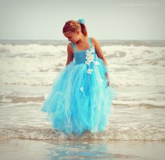 Ok so maybe this color with the starfish in her hair but not the top part of the dress just all in the tutu form.