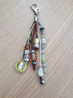 Bag or key chain, green brown witha variety of beads. Handmade jewelry