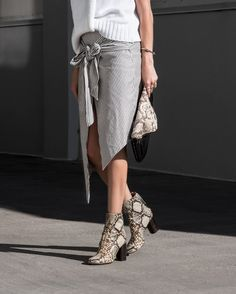 Spice up the stripes by pairing them with some snakeskin patterned boots! Via Amanda Shadforth Skirt: Sir The Label, Boots: Isabel Marant