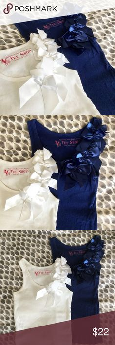 | bow tank bundle | Feminine details on a classic tank. The deets: one white + one navy blue EUC bow embellished tank tops | size s | vs brand | adorable on their own or layered for an ultra chic look | contact for questions | no trades or lowball offers | ❤️ Victoria's Secret Tops Tank Tops