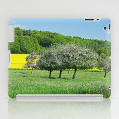 Orchard in the sea of dandelions and rapeseed fields iPad Case by Tanja Riedel - $60.00