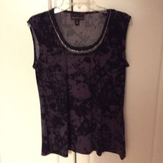 PURPLE BLACK SILVER COLLARD BEAD WORK GORGES TOP BLACK & PURPLE DANA BUCHMAN TOP WITH  SILVER BEADWORK AROUND THE COLLAR . VERY GENTLY PRE-LOVED IN EXCELLENT SZ M    CONDITION 95 % POLYESTER 5 % SPANDEX.    EXCLUSIVE OF DECORATION.  SMOKE FREE HOME . THANK YOU SO VERY MUCH FOR VISITING MY CLOSET ALLISON :):):):):) Dana Buchman Tops Blouses