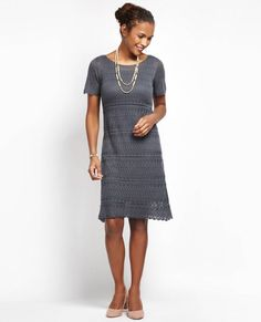 A timeless lace dress gets a playful update this season in slate grey. Boasting a lined body and semi-sheer sleeves, this frock is perfect for making a statement at your next event while the classic s