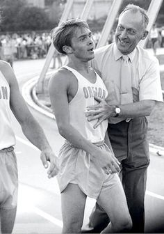 Freshman Steve Prefontaine,  age 19,  with coach Bill Bowerman, June 5 1970, Oregon Twilight Meet, Hayward Field, Eugene OR, Pre places 2nd in mile with 3:57.4 time, his first sub-four minute mile.