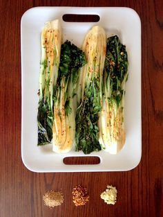 spicy roasted bok choy: tossed with olive oil, seasame oil, soy sauce, garlic, red pepper flakes & sesame seeds, roasted at 400 F for 6-7 minutes